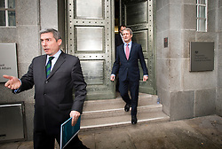 © London News Pictures. 09/02/2013 . London, UK.  Secretary of State for Environment, Food and Rural Affairs, OWEN PATERSON (right) leaving the Department for the Environment, Food and Rural Affairs in London to talk to the media after meeting with representatives of the FSA, as well as food retailers and suppliers, to discuss the unfolding scandal over horsemeat being found in various products.. Photo credit : Ben Cawthra/LNP