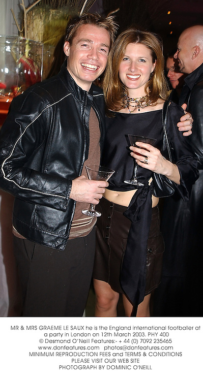 MR & MRS GRAEME LE SAUX he is the England international footballer at a party in London on 12th March 2003.PHY 400