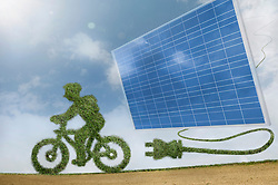 Eco friendly green bicycle just unplugged from a green energy source solar panels, Bavaria, Germany