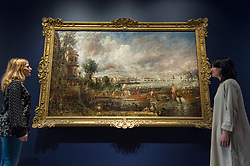 "© Licensed to London News Pictures. 11/01/2019. LONDON, UK. Staff members view ""The Opening of Waterloo Bridge ('Whitehall Stairs, June 18th, 1817')"" by John Constable.  The painting is being shown with ""Helvoetsluys"", 1832, by J.M.W. Turner (R) at The Royal Academy of Arts in Piccadilly for the first time since the artists clashed at the Summer Exhibition in 1832.  Turner allegedly added a small dab of red paint to his canvas, which he then converted into an image of a buoy floating in the sea. when he saw his painting next to Constable's.  The two works form ""He has been here and fired a gun"": Turner, Constable and the Royal Academy, on display from 12 January to 31 March 2019.  Photo credit: Stephen Chung/LNP"