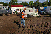 Heavy rain created a mud bath in the Shangri La camping field,  Glastonbury Festival 2016, United Kingdom. Glastonbury Festival is the largest greenfield festival in the world, and is now attended by around 175,000 people. Its a five-day music festival that takes place near Pilton, Somerset. In addition to contemporary music, the festival hosts dance, comedy, theatre, circus, cabaret, and other arts. Held at Worthy Farm in Pilton, leading pop and rock artists have headlined, alongside thousands of others appearing on smaller stages and performance areas.