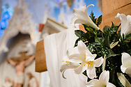 Easter lilies with the reredos and statue depicting Jesus Christ, seen on Monday, April 5, 2021, at Immanuel Lutheran Church, St. Charles, Mo. LCMS Communications/Erik M. Lunsford