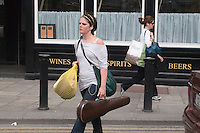 Woman carrying violin case in Dublin Ireland
