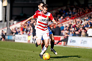 Doncaster Rovers midfielder Matty Blair (17) is fouled by Scunthorpe United midfielder Levi Sutton (22)  during the EFL Sky Bet League 1 match between Scunthorpe United and Doncaster Rovers at Glanford Park, Scunthorpe, England on 23 February 2019.