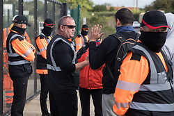An activist holds up his injured hand after he was forcibly removed by security guards acting for HS2 whilst superglued to the road in front of a gate providing access to a site for the HS2 high-speed rail link on 12 September 2020 in Harefield, United Kingdom. Anti-HS2 activists continue to try to prevent or delay works on the controversial £106bn HS2 high-speed rail link in the Colne Valley where thousands of trees have already been felled.