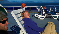 Jonathan and Christina Sleeping in the Afternoon Sun. Solarium Deck on the M/V Columbia Alaska Marine Highway Between Bellingham, Washington and Haines, Alaska. Image taken with a Nikon D3 and 50mm f/1.4 lens (ISO 200, 50 mm, f/11, 1/500 sec).