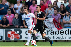 (L-R) Filipe de Andrade Texeira of Steaua Bucharest, Noussair Mazraoui of Ajax during the friendly match between Ajax Amsterdam and Steaua Bucharest on July 7, 2018 at Sportpark Achterveen in Hattem, The Netherlands