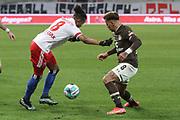 Fussball: 2. Bundesliga, FC St. Pauli - Hamburger SV, Hamburg, 01.03.2021<br /> Jeremy Dudziak (HSV, l.) -  Rodrgio Zalazar (Pauli)<br /> © Torsten Helmke