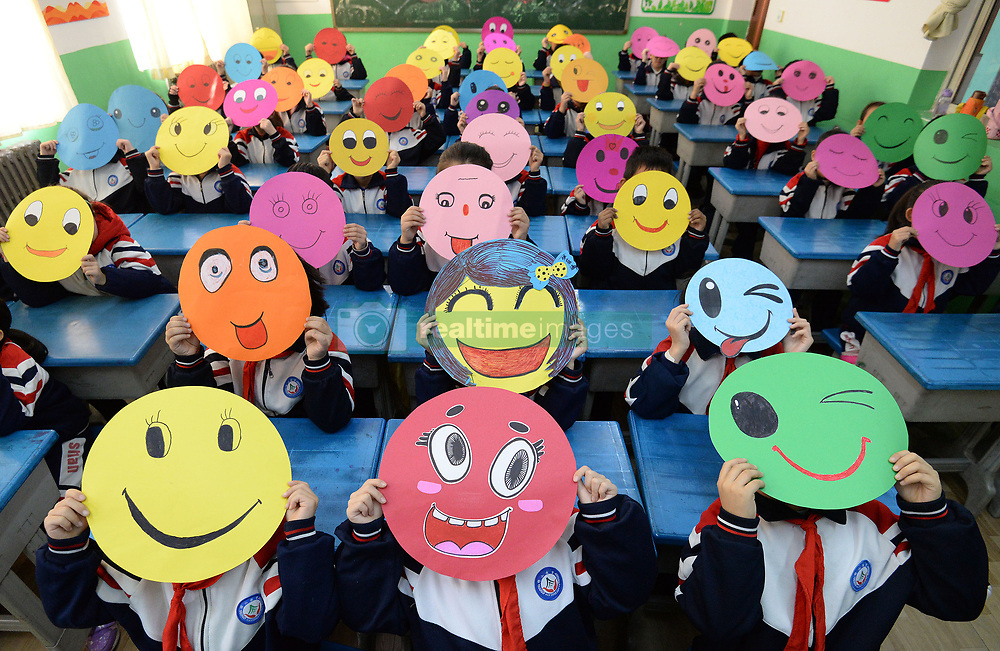 November 20, 2018 - Handan, China - Young students draw paintings of smiling faces at a primary school in Handan, north China's Hebei Province, marking the World Hello Day. The World Hello Day began in response to the conflict between Egypt and Israel in the Fall of 1973.  Since then, World Hello Day has been observed by people in 180 countries. (Credit Image: © SIPA Asia via ZUMA Wire)