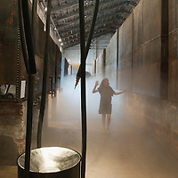 """VENICE, ITALY - JUNE 04: A woman walks  towards the installation """"I Plead: Rain"""" by Liang Yuanwei inside the Chinese Pavillion on June 4, 2011 in Venice, Italy. This year's Biennale is the 54th edition and will run from June 4th until November 27."""