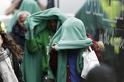 Licensed to London News Pictures. 20/10/2016. Croydon, UK. Migrants from the Calais jungle camp arrive at the Home Office immigration centre in Croydon. British authorities are bringing over about 100 children this week to be reunited with their relatives. French authorities are expected to start dismantling the camp this week. Photo credit: Peter Macdiarmid/LNP