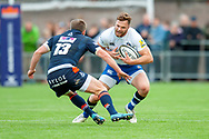 Max Wright of Bath Rugby tries to evade the tackle of James Johnstone of Edinburgh Rugby during the Rugby Friendly match between Edinburgh Rugby and Bath Rugby at Meggetland Sports Complex, Edinburgh, Scotland on 17 August 2018.