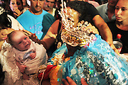 A Gitan child is taken close to Saint Sara, in the church during the Gypsy Pilgrimmage of Saintes Maries de la Mer<br /><br /> Europe, France, Camargue, Saintes Maries de la Mer, Gypsy Pilgrimmage 'Pelerinage des Gitans aux Saintes Maries de la Mer'. Gypsies from all over the world come to celebrate their patron Saint Sara who is carried by them from the church to the sea-shore. May 24th and 25th every year