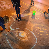 011114       Cable Hoover<br /> <br /> ArtsCrawl patrons create large chalk drawings in the middle of Coal Avenue during ArtsCrawl in downtown Gallup Saturday.