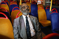 Man travelling on an empty bus,