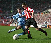 Photo. Andrew Unwin.<br /> Sunderland v Coventry, Coca-Cola Championship, Stadium of Light, Sunderland 19/03/2005.<br /> Coventry's Richard Duffy (L) looks to tackle Sunderland's George McCartney (R).