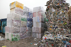Stacks of paper bales ready for distribution to papermill for recycling,