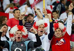 Fans of England celebrate after the 2010 FIFA World Cup South Africa Group C Third Round match between Slovenia and England on June 23, 2010 at Nelson Mandela Bay Stadium, Port Elizabeth, South Africa.  (Photo by Vid Ponikvar / Sportida)