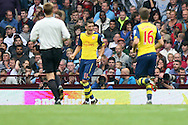 Mezut Ozil of Arsenal celebrates scoring his side's first goal. Barclays Premier league match, Aston Villa v Arsenal at Villa Park in Birmingham on Saturday 20th Sept 2014<br /> pic by Mark Hawkins, Andrew Orchard sports photography.