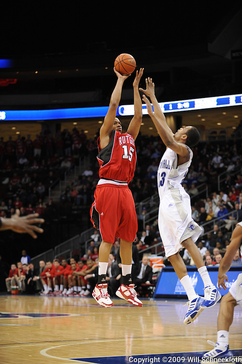 Jan 29, 2009; Newark, NJ, USA; Rutgers forward J.R. Inman (15) takes a shot from the top of the key over Seton Hall forward Robert Mitchell (23) during the first half of Seton Hall's 70-67 victory at the Prudential Center.