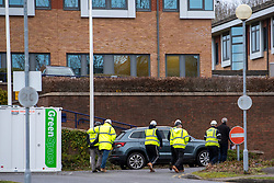 © Licensed to London News Pictures. 08/02/2020. Milton Keynes, UK. Contractors walk next to a portacabin at the entrance to the Kents Hill Park Conference Centre. A Milton Keynes conference centre is to house evacuees from the Chinese city of Wuhan, the epicentre of the Novel Coronavirus (2019-nCoV) outbreak, the British citizens are due to be flown back on Sunday 9th February and are expected to land at RAF Brize Norton in Oxfordshire and will remain at the Kents Hill Park Training and Conference Centre for 14 days to be monitored. Photo credit: Peter Manning/LNP