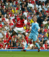 Photo. Chris Ratcliffe. Digitalsport<br /> Arsenal v Bolton Wanderers. Barclays Premiership. 18/09/2004<br /> Kolo Toure Arsenal goes up for an aerial ball with Kevin Nolan of Bolton
