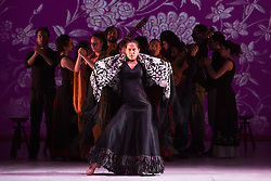 "© Licensed to London News Pictures. 20/02/2015. London, England. Pictured: artistic director Rafaela Carrasco performs in front of her troupe. Ballet Flamenco de Andalucía perform ""Las Cuatro Esquinas"" from their production ""Images: 20 Years"" during the Flamenco Festival London 2015 at Sadler's Wells Theatre. The show runs from 20-21 February with the festival running from 16 February to 1 March 2015.  Photo credit: Bettina Strenske/LNP"