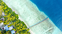 Aerial view of an abondoned jetty, crossing the reef of local island Omadhoo, Alif Dhaal Atoll, Maldives, Indian Ocean