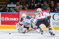 KELOWNA, CANADA - FEBRUARY 10: Devante Stephens #21 clears the puck from the crease in front of Brodan Salmond #31 of the Kelowna Rockets against the Vancouver Giants on February 10, 2017 at Prospera Place in Kelowna, British Columbia, Canada.  (Photo by Marissa Baecker/Shoot the Breeze)  *** Local Caption ***