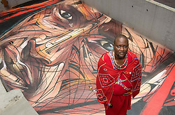 November 10, 2016 - Hong Kong, Hong Kong S.A.R, China - Masai warrior and representative of the Big Life foundation in Kenya,Daniel Ole Sambu, with the rooftop painting of himself painted by famous Parisian street artist Alexandre Monteiro aka Hopare..Street art in Hong Kong ahead of the The √íHope for Wildlife√ì Gala Dinner painted to raise awareness for the plight of endangered animals the world over..10th November 2016. Photo by Jayne Russell. (Credit Image: © Jayne Russell via ZUMA Wire)