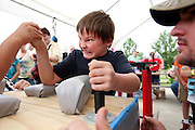 Jayden Calabro, 9, of Denver, Colorado, competes in the arm wrestling competition at Sauerkraut Days in Henderson, MN, June 23, 2012.  Though he lost this match, Jayden went on to win 2nd place in the left-hand category.