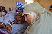 Before continuing to the first-ever international Conference on Womens' Challenge in Darfur, British Muslim activist, TV broadcaster and journalist, Yvonne Ridley hears the views of another woman during speeches inside the 4 sq km camp Abo Shouk refugee camp, which is (disputedly) home to 38,000 displaced persons, on the outskirts of Al Fasher, Sudan.