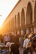 People in old medina market in sunset sunlight, Casablanca, Morocco