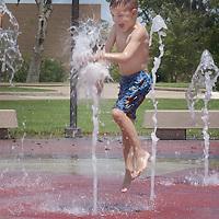 Antonio Montemayor, 6, enjoys the enter-active fountain behind the Lake Jackson Civic center, 08/17/02.
