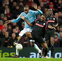 MANCHESTER, ENGLAND - Sunday, February 13, 2010: Manchester City's Emmanuel Adebayor and Stoke City's Salif Diao during the FA Cup 5th Round match at the City of Manchester Stadium. (Photo by David Rawcliffe/Propaganda)  MANCHESTER, ENGLAND - Sunday, February 13, 2010: Manchester City xxxx and Stoke City's xxxx during the FA Cup 5th Round match at the City of Manchester Stadium. (Photo by David Rawcliffe/Propaganda)