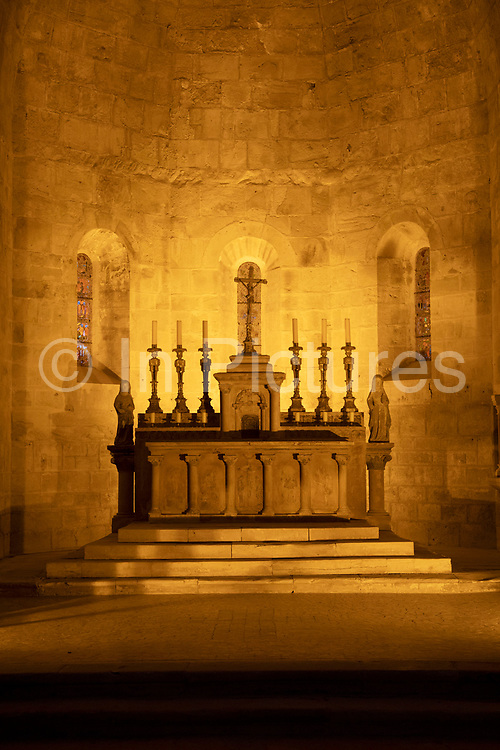 Abbey Church altar at Fontfroide Abbey near Narbonne, France. Fontfroide Abbey is a former Cistercian monastery in France, situated 15 kilometers south-west of Narbonne. It was founded in 1093 by Aimery I, Viscount of Narbonne, but remained poor and obscure, and needed to be refounded by Ermengarde, Viscountess of Narbonne. The abbey fought together with Pope Innocent III against the heretical doctrine of the Cathars who lived in the region. It was dissolved in 1791 in the course of the French Revolution. The premises, which are of very great architectural interest, passed into private hands in 1908, when the artists Gustave and Madeleine Fayet dAndoque bought it to protect the fabric of the buildings from an American collector of sculpture. They restored it over a number of years and used it as a centre for artistic projects. It still remains in private hands. Today it is open to paying guests.