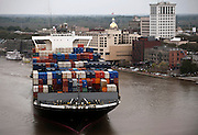 The NYK Arcadia sails past historic River Street on the way up river to the Georgia Ports Authority Garden City Terminal, Saturday, March, 27, 2014, in Savannah, Ga.  (GPA Photo/Stephen B. Morton)