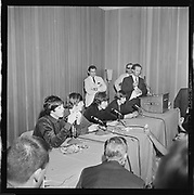 Y-650822A-03. Beatles at Memorial Coliseum press conference. August 22, 1965