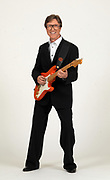 Legendary guitarist Hank Marvin from The Shadows with his red fender guitar in the INEC Killarney in 2009.<br /> Picture by Don MacMonagle -macmonagle.com