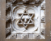 Historic interior of East Bergholt church, Suffolk, England, UK baptismal font stonework detail Star of David