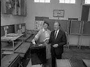 Charles Haughey Votes in Referendum..1983.07.09.1983.09.07.1983.7th September 1983..Photo of Mr Haughey,.leader of Fianna Fail,and his wife Maureen cast their votes in the National School,Kinsealy,Dublin... The referendum was a constitutional amendment with regard to the life of the unborn...  It was a divisive campaign with much debate, charge and countercharge by both sides of the argument..Those in the Yes campaign won the day with a vote of 841,233 to a no vote of 416,136.