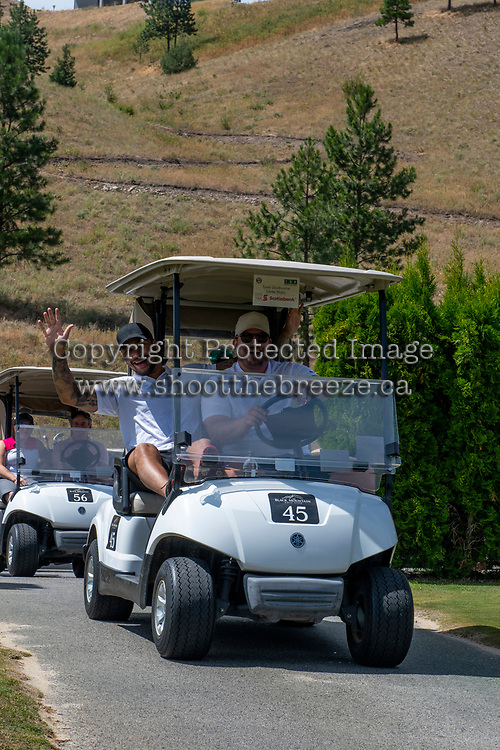 KELOWNA, CANADA - JULY 21: Alumni Tyrell Goulbourne shares a golf cart with Carter Rigby at the Kelowna Rockets Alumni golf tournament at Black Mountain Golf Club in Kelowna, British Columbia, Canada.  (Photo by Marissa Baecker/Shoot the Breeze)  *** Local Caption ***