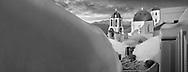 Sacred Stone - Black and white photo art print of blue domed Greek Orthodox churches of Santorini Island Greece by Paul Williams.