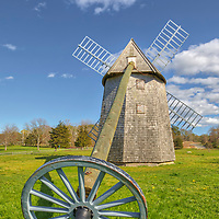 New England photography of the historic Higgins Farm Windmill also known as Brewster Windmill off of Old King's Highway at Drummer Boy Park in Brewster on Cape Cod in Massachusetts. This smock windmill converted wind power into rotational energy.<br />
