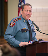Chief Mock addresses the audience during a swearing-in ceremony for new officers at the Houston ISD Police Department, March 3, 2014.
