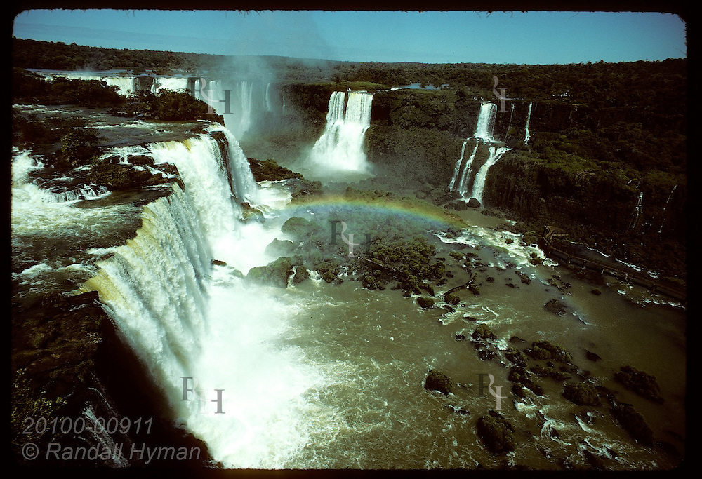 View of Iguassu Falls with rainbow, Brazilian side in foreground, Argentine side in background. Brazil