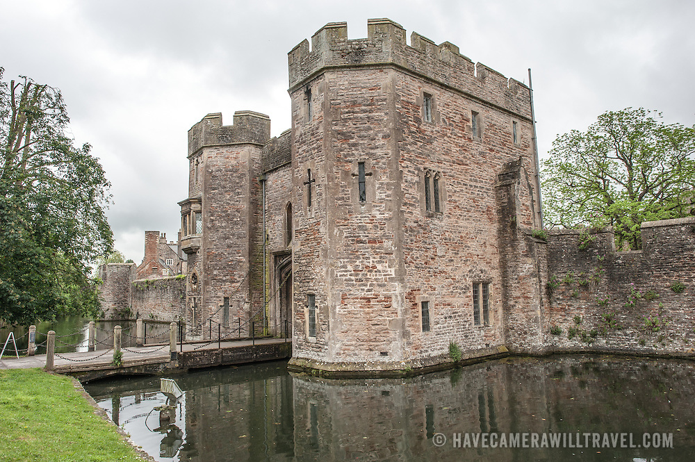 The gatehouse and drawbridge over the moat at Bishop's Palace in Wells, Somerset, England.