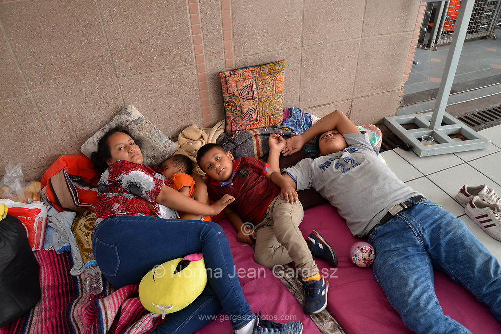 Families from Guatemala and Mexico seeking asylum in the United States wait for many days at the port-of-entry in Nogales, Sonora, Mexico for US officials to interview them at the customs office Nogales, Arizona, USA.