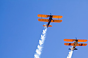 30 MAY 2011 - PHOENIX, AZ: A flyover of Stearman Biplanes in the Primary Trainer Squadron of the Arizona Antique Airplane Association at Memorial Day services in the National Memorial Cemetery in Phoenix, AZ, Monday. Memorial Day was celebrated with services across the United States Monday.    Photo by Jack Kurtz