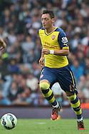 Mesut Ozil of Arsenal in action. Barclays Premier league match, Aston Villa v Arsenal at Villa Park in Birmingham on Saturday 20th Sept 2014<br /> pic by Mark Hawkins, Andrew Orchard sports photography.